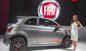 A model stands next to a FIAT 500e at the LA Auto Show in Los Angeles, Thursday, Nov. 29, 2012 at the Los Angeles Convention Center. Te Show will open to the public on November 30 and runs through December 9.