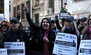 Employees of the Greek Social Security Foundation (IKA) shout slogans againts austerity measures during a protest held outside the Labour Ministry in Athens on December 7, 2012.