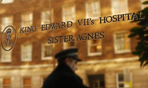 Policeman reflected in plaque outside King Edward VII hospital, where Jacintha Saldanha worked
