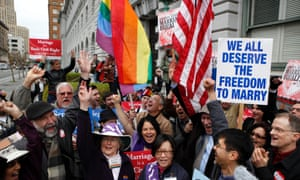 Gay Marriage advocates cheer during a rally moments before hearing the news of the Proposition 8 over-ruling outside the Ninth Circuit Courthouse in San Francisco, California, 7 February 2012.