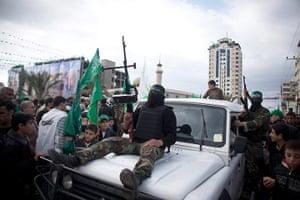 Hamas: Militants ride past crowds of Palestinians