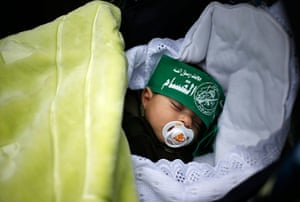 Hamas: A baby wearing a Hamas headband sleeps