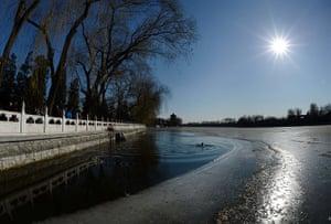 24 hours: Beijing, China: An ice swimmer in Houhai lake