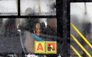 24 hours: Belgrade, Serbia: An elderly woman looks out of a bus window