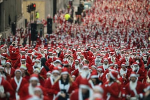 24 hours: Glasgow, Scotland: A thousand people take part in the annual Santa Dash