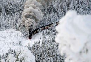 24 hours: Wernigerode, Germany: A train on a narrow-gauge railway line steams through a snow-covered forest
