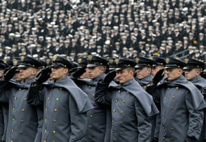 24 hours: Philadelphia, US: Army cadets salute as they march on to an American football field