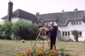 Patrick Moore outside his home in Selsey, West Sussex, in 1989