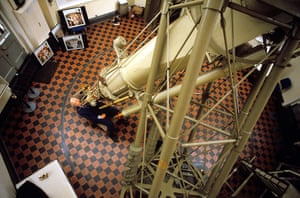 Patrick Moore sits at the 28-inch refracting telescope in the Royal Observatory in Greenwich in 1990