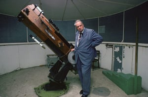 Patrick Moore with a wooden 15-inch Newtonian reflector telescope in his observatory at home in West Sussex in 2001