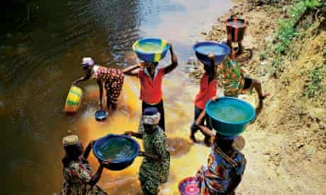 Collecting water from the river, Liberia
