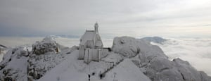 Cold snap continues: People walk below a frost covered Wendelstein church near Bayrischzell