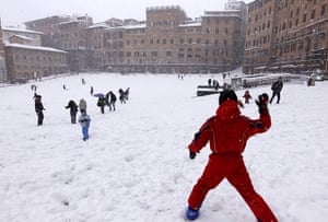Cold snap continues: Children throw snowballs in Siena's Piazza del Campo, Italy