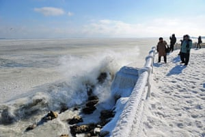 Cold snap continues: People photograph the frozen sea in Constanta, Romania
