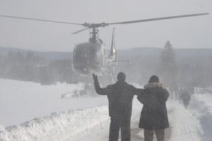 Cold snap continues: Bosnian people waving to helicopter crew as they wait for food supplies