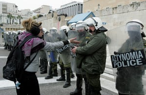 Strikes in Greece: A protester speaks with police in front of the Greek Parliament in Athens