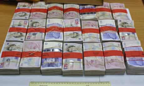 Banknotes seized by HMRC investigators from the gang jailed for alcohol-smuggling