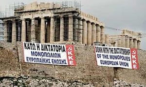 Greek protesters mount banners in front of the Parthenon