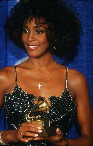 Whitney Houston obit: 1987: Whitney Houston holds her award at the Grammy's