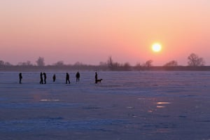 UK weather: Enthusiasts Attempt To Skate On The Frozen Fens