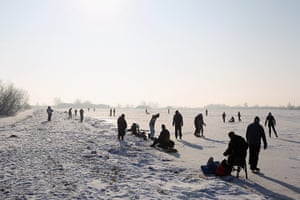 UK weather: Enthusiasts skate on a frozen fen in Sutton