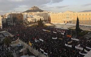 Athens demo: Thousands of people take part in an anti-austerity demonstration in Athens