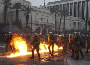 Athens demo: A petrol bomb explodes near riot police