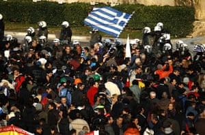Athens demo: Anti-austerity protesters wave a Greek flag in Athens