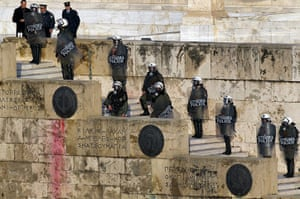 Athens demo: Police in riot gear stand guard outside the parliament