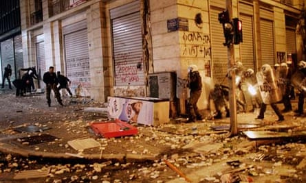 Greece approves austerity cuts to secure bailout and avoid debt default