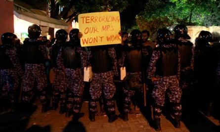A supporter of former Maldives president Mohamed Nasheed shouts slogans
