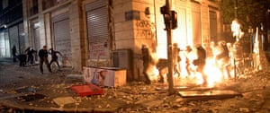 Greece unrest: Demonstrators throw fire bombs at riot police during violent protests