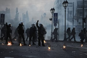 Greece unrest: riot police stand guard near the Greek parliament