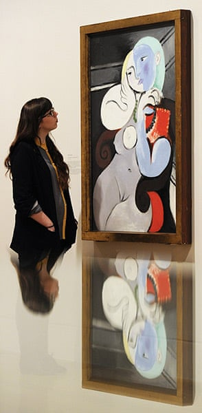 Picasso & Modern Brit Art: An employee poses next to a 1932 painting by Pablo Picasso