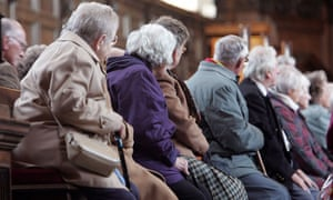 Elderly people listen to a tour guide ahead of publication of British Pensions Commission report