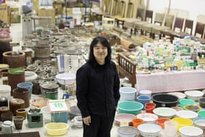 Song Dong installation: Chinese artist Song Dong stands in his installation entitled Waste Not