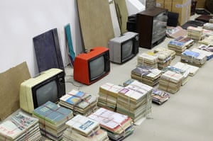 Song Dong installation: Several portable televisions in the installation