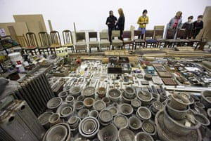 Song Dong installation: Chairs, tools and plant pots in the installation