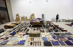 Soon Dong installation: Pairs of shoes and folded clothes