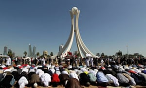 Bahraini anti-government protesters pray at the Pearl roundabout in Manama in February 2011
