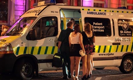 An ambulance tends to someone suffering the effects of excess alcohol