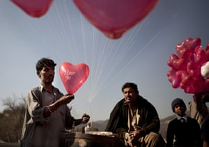 24 hours: Islamabad, Pakistan: A man prepares balloons for Valentines Day