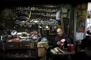 24 hours: Cairo, Egypt: A man wraps copper wire onto a coil in his workshop