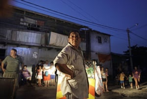 24 hours: Asuncion, Paraguay: Residents watch as homes burn in Chacarita slum