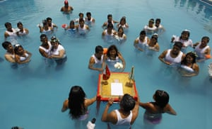 24 hours: Ventanilla, Peru: Couples get married in a pool on Valentine's Day