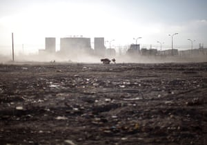 24 hours: Hohhot, China: The wind blows up dust at a demolition site