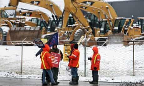 EMD workers picketing a Caterpillar digger dealership