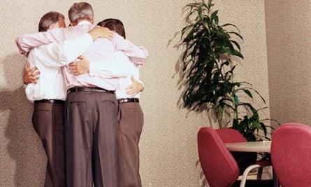 A group of businessmen hugging