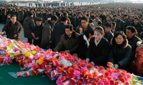 North Koreans offer flowers to mark the 70th anniversary of the birth of Kim Jong-il