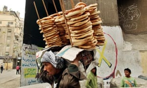 Man sells bread near the Interior Ministry in Cairo